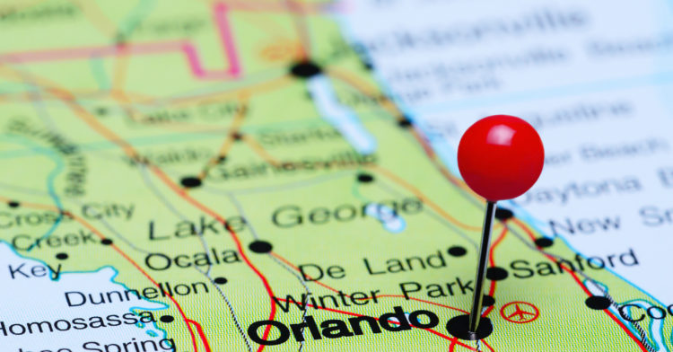 Photo of pinned Orlando on a map of USA. May be used as illustration for traveling theme.